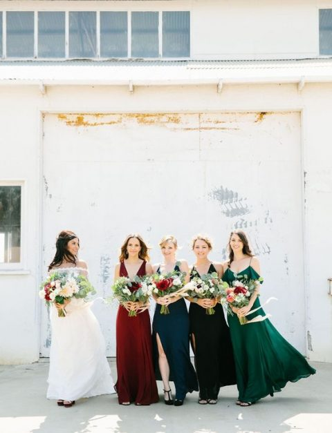mismatched jewel-tone bridesmaids_ dresses in emerald, burgundy, teal and black