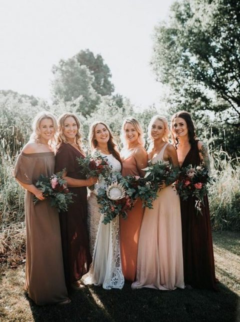mismatching bridesmaids_ dresses in blush, burgundy, rust and grey with all different designs