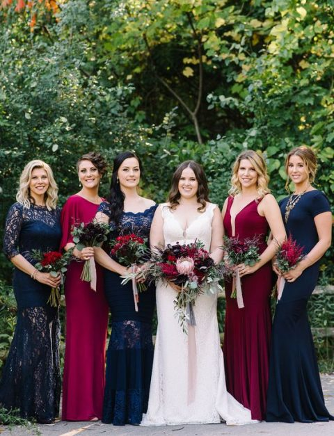 navy and fuchsia bridesmaids_ gowns with various designs and lace inserts