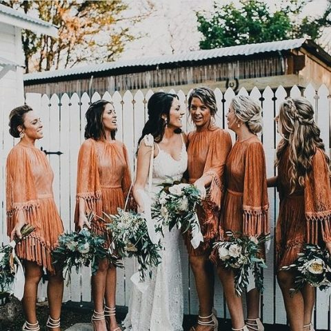 same orange knee dresses with long sleeves and long fringe for a bold fall boho look