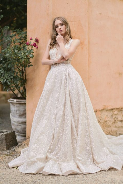 07 a gorgeous sparkling A-line wedding dress with a plunging neckline and a train