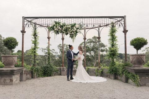 15 a fantastic ceremony space done with a large pergola decorated with lush greenery and blooms