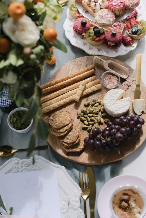 18 a cheese board with fruit