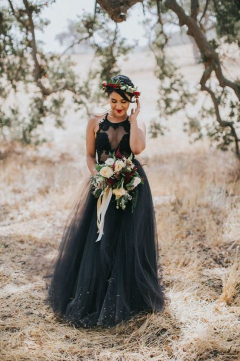 a black A-line wedding dress with a halter illusion neckline and a layered tulle skirt
