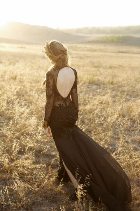 a black mermaid wedding dress with lace and embellishments plus a cutout back