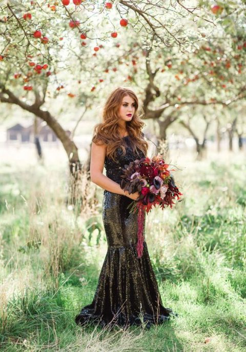 a black sequin mermaid wedding dress with a lace bodice