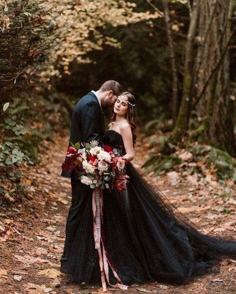 a black strpaless princess-style wedding gown with a lace bodice and a layered skirt