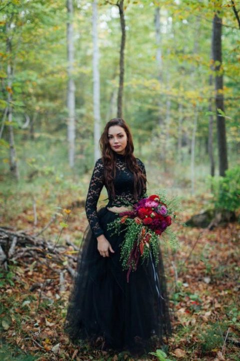 a black wedding separate with a black lace bodice with long sleeves and a layered skirt