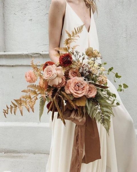 a blush and terra cotta wedding bouquet with gilded ferns