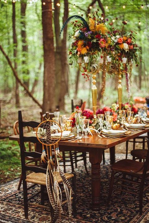 a boho woodland table setting with jewel-tone blooms and gilded touches for a lux feel