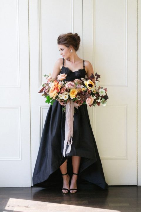a chic black spaghetti strap wedding dress with a lace bodice and a high low skirt