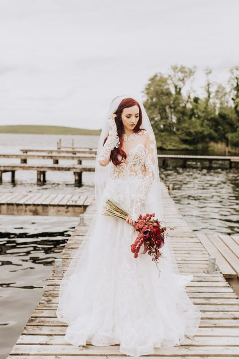 a chic princess-style wedding dress with a lace bodice and sleeves and lace gloves