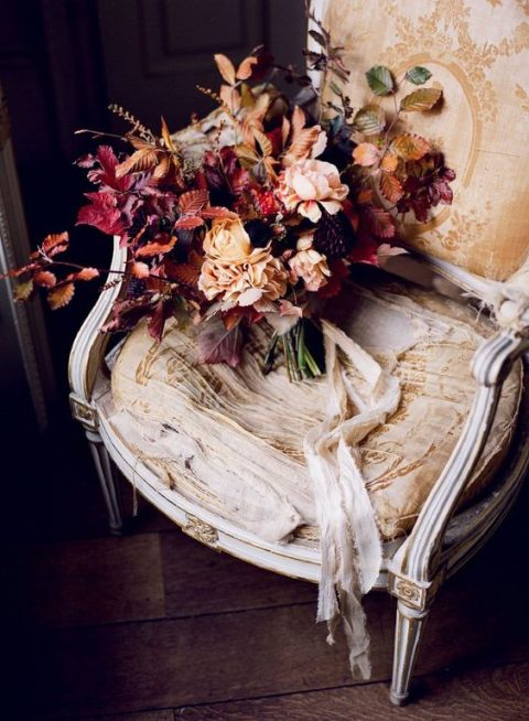 a decadent wedding bouquet with blush and deep purple blooms plus fall foliage