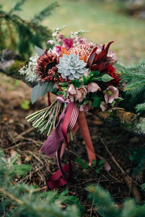 a fall boho wedding bouquet with burgundy and pink blooms plus succulents