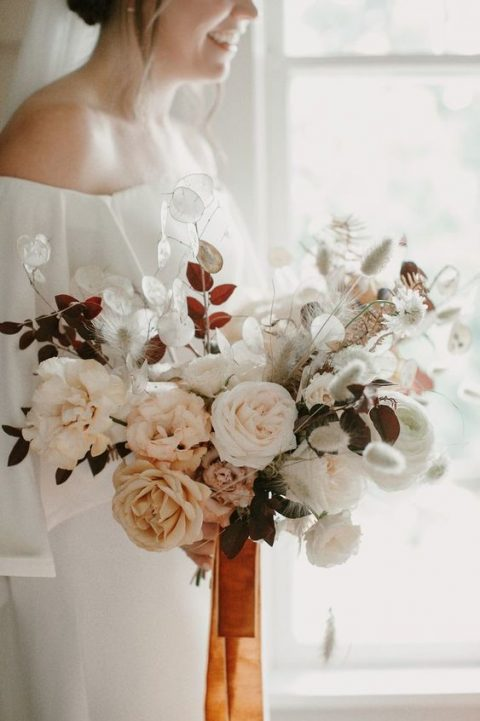 a fantastic fall wedding bouquet with dried lunaria, grasses, fall leaves and garden roses