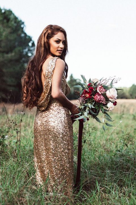 a gold sequin wedding dress with an open back