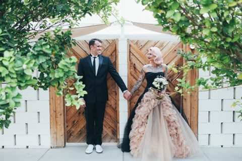 a gorgeous strapless black wedding dress with blush ruffles and tulle for a wow effect