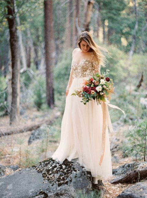 a gorgeous wedding dress with a gold lace applique bodice and a flowy skirt