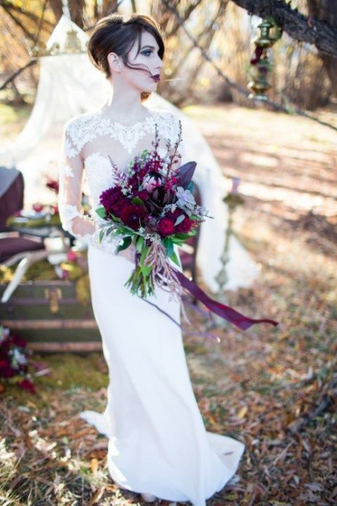 a purple and dark blooms plus pale succulents for a jewel-tone wedding bouquet