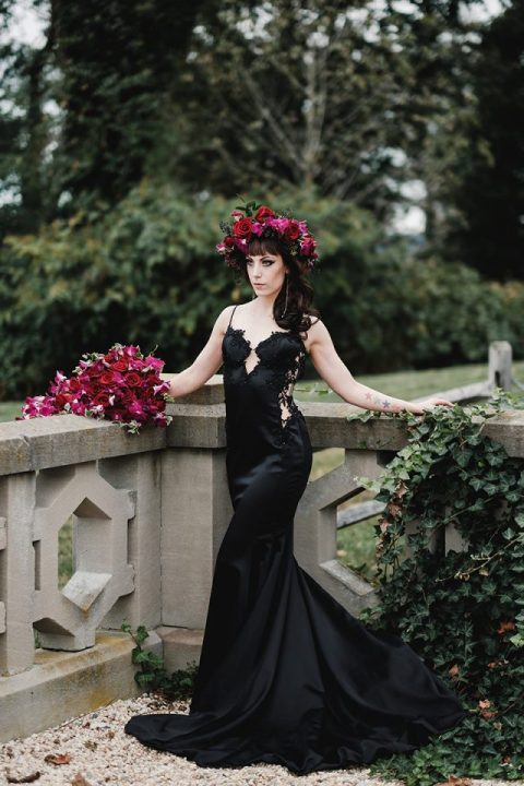 a sexy black mermaid silk wedding gown with lace inserts and an embellished bodice