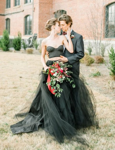 a striking two piece wedding dress with a plain strapless top and a layered skirt with a slit