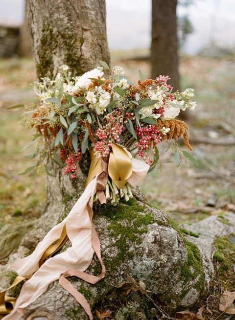 a subtle fall wedding bouquet with greenery, rust and white touches
