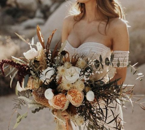 a textural boho wedding bouquet with peachy and creamy blooms, grasses and foliage