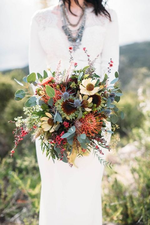 a textural boho wedding bouquet with yellow blooms, pincushion proteas and herbs and foliage