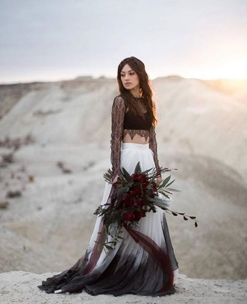 a trendy look with a black lace crop top and an ombre skirt in white and black