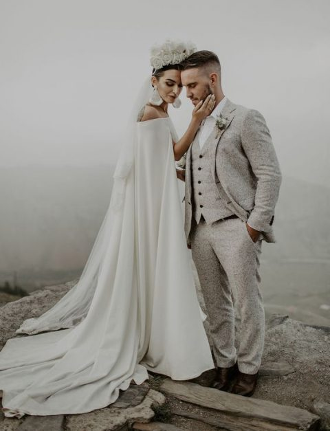 a tweed suit is a comfy ideafor the groom and a cape is a trendy idea for the bride