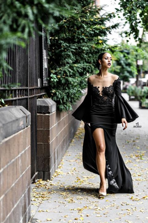 a unique black wedding gown with an illusion neckline, a lace bodice and bell sleeves plus a slit