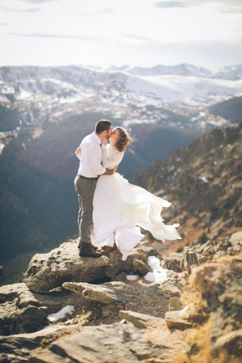 a white sweater is a good choice for a bridal coverup in the mountains