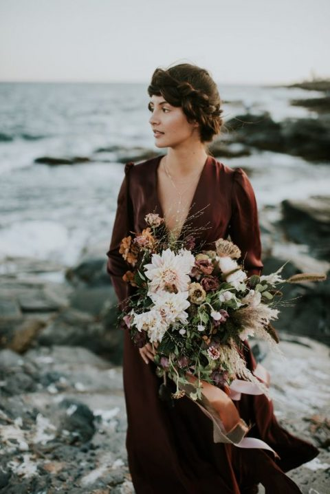 an earthy wedding bouquet with brown and rust blooms plus blush ones and pampas grass