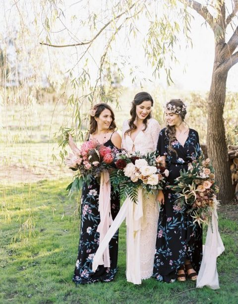 black floral maxi dresses with various necklines and floral headpieces