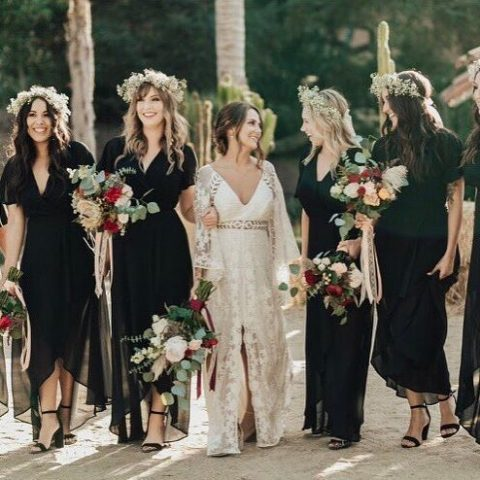 black midi dresses with high low skirts and floral crowns for a boho wedding