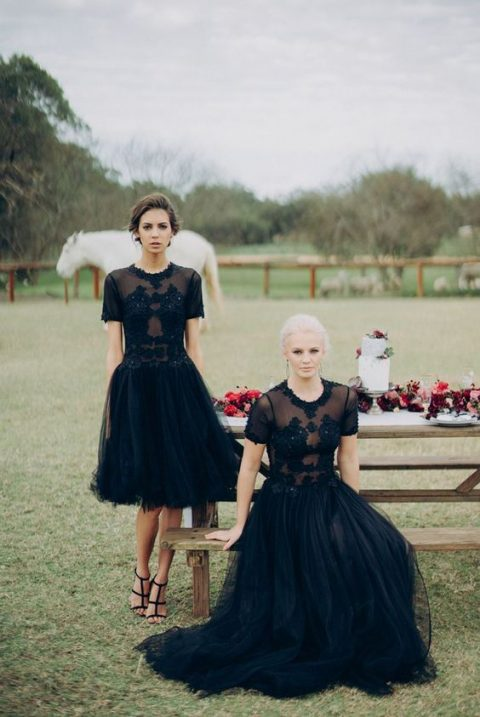 chic black bridesmaid dresses with lace embellished bodices and tulle skirts