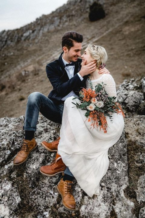 comfy brown boots for both is a cool and cozy idea for a mountain ceremony