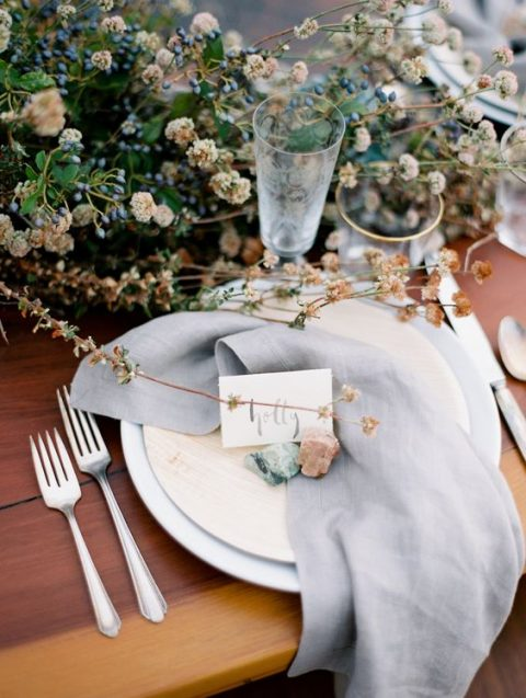 dried blooms, berries, herbs and rocks are right what you need for organic modern table decor