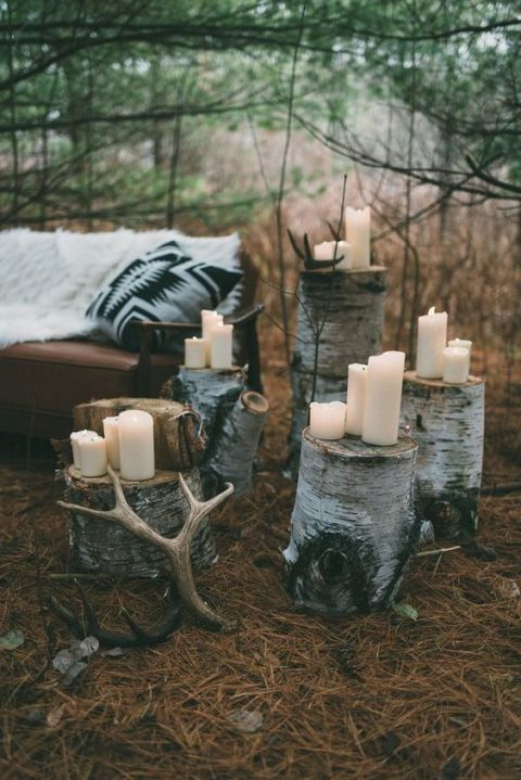 tree stumps with candles and antlers for a woodland look