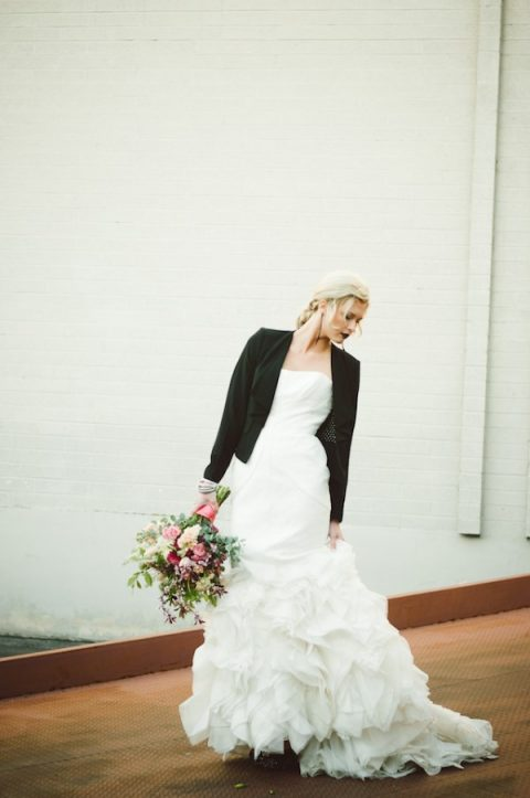 a black jacket and a black bridal lip to make the romantic dress stand out