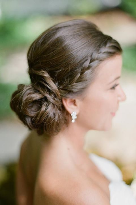 a braid going into a messy low bun on the right side for an elegant yet not too formal look