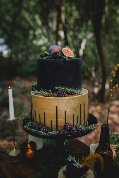 a chic black and gold cake with handpainting and figs and blackberries