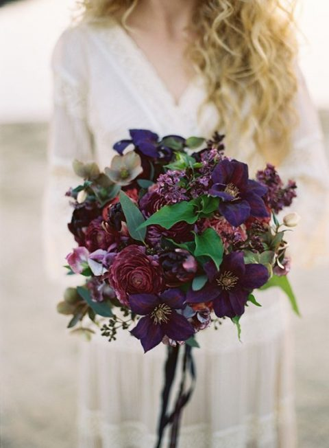 a chic deep purple and dusty pink wedding bouquets with foliage and rbbons