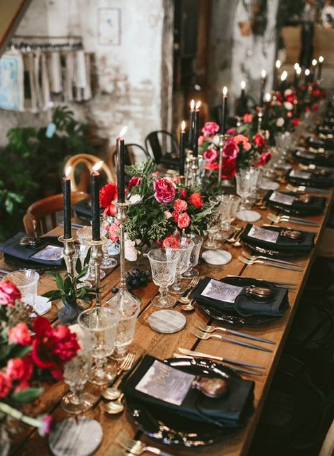 a chic table setting with touches of black and brass plus bold florals for a Halloween bridal shower