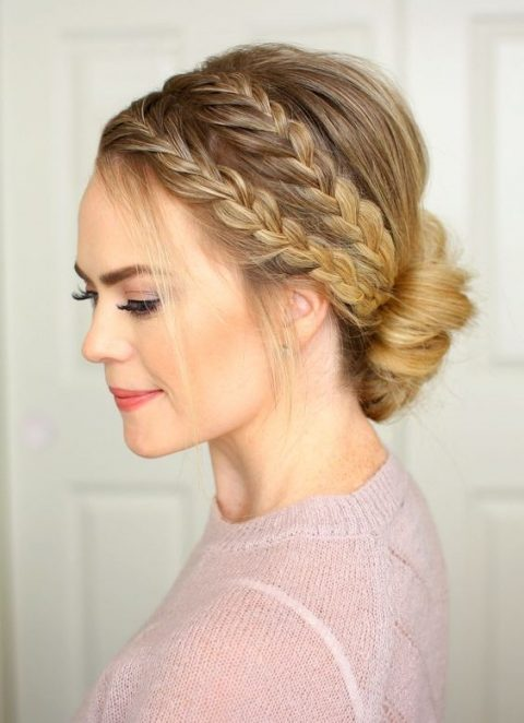 a double braid halo low bun and some locks down for a rustic or boho bride