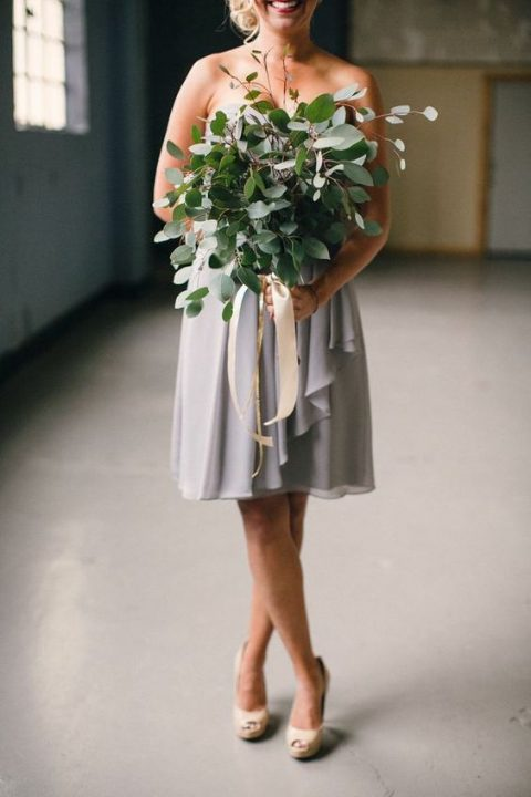 a foliage wedding bouquet with blush ribbons for a bridesmaid