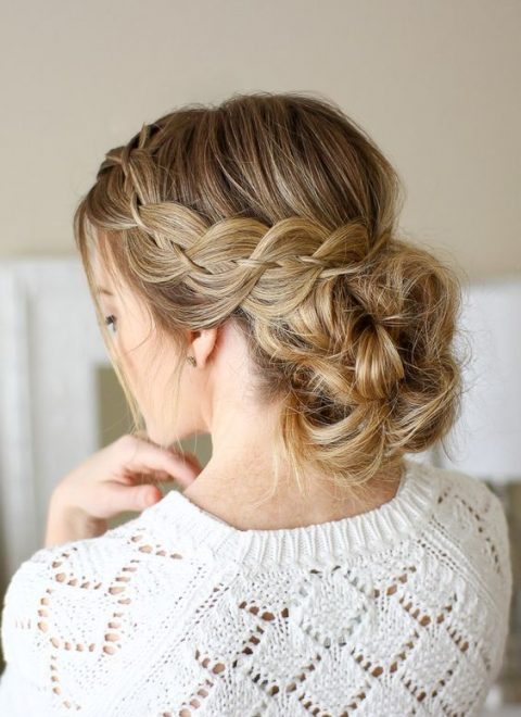 a four strand braid with a messy low bun with a bump is an amazing idea for a boho bride
