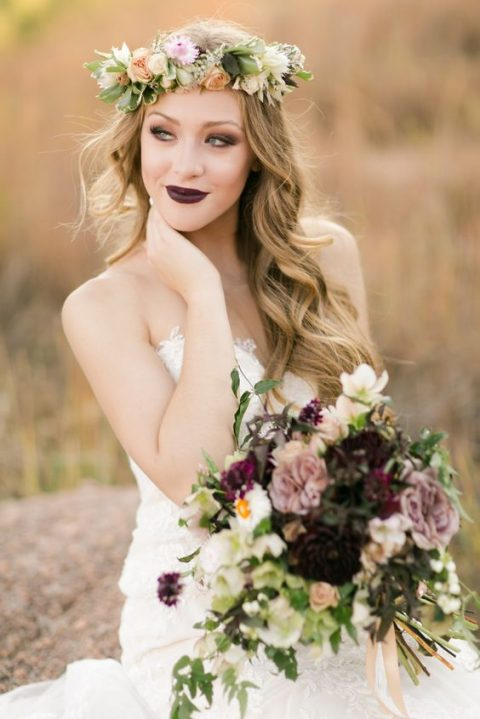 a gardeb bride with breezy hair, romantic florals and a dark lipstick for a statement