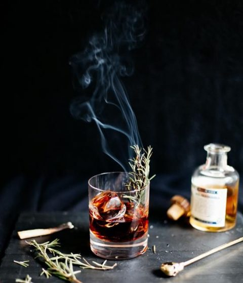 a gorgeous smoked Halloween cocktail with rosemary