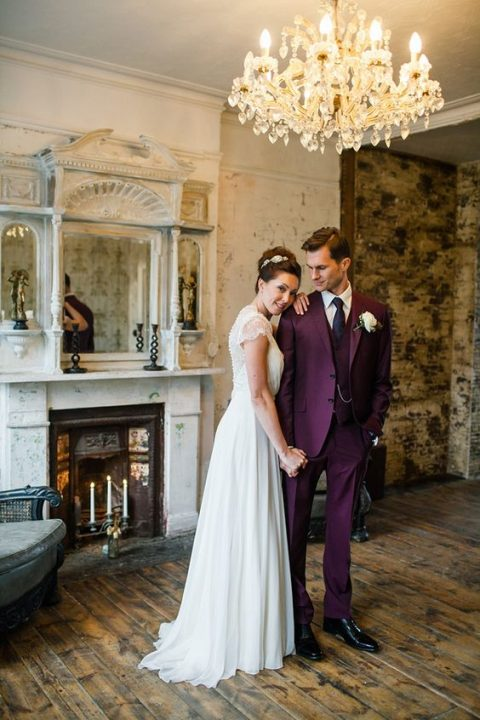 a gorgeous three-piece purple wedding suit with a violet tie and black shoes